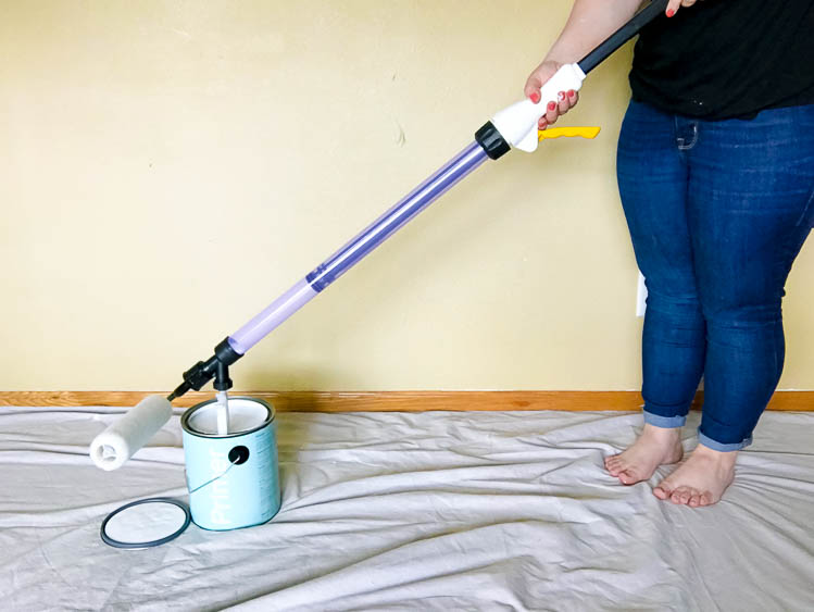 woman-filling-smart-roller-with-paint