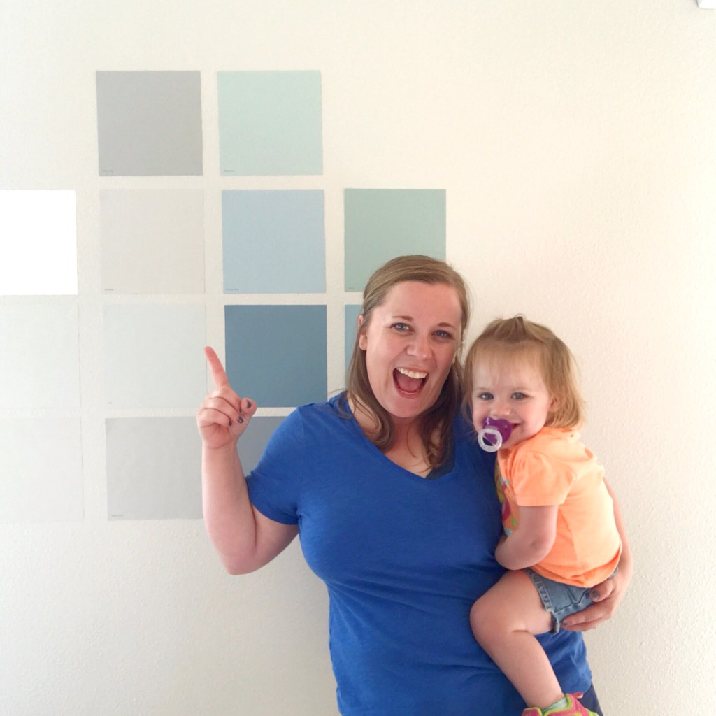 emily-counts-iowa-blogger-in-front-of-clare-paint-swatches