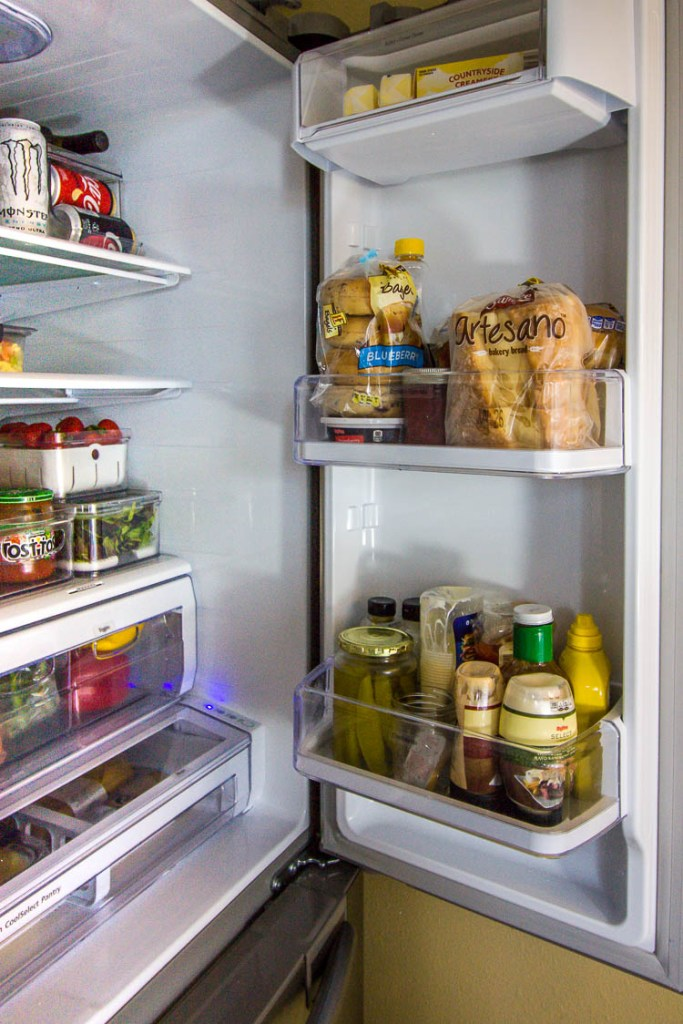 organized-condiments-in-fridge-door