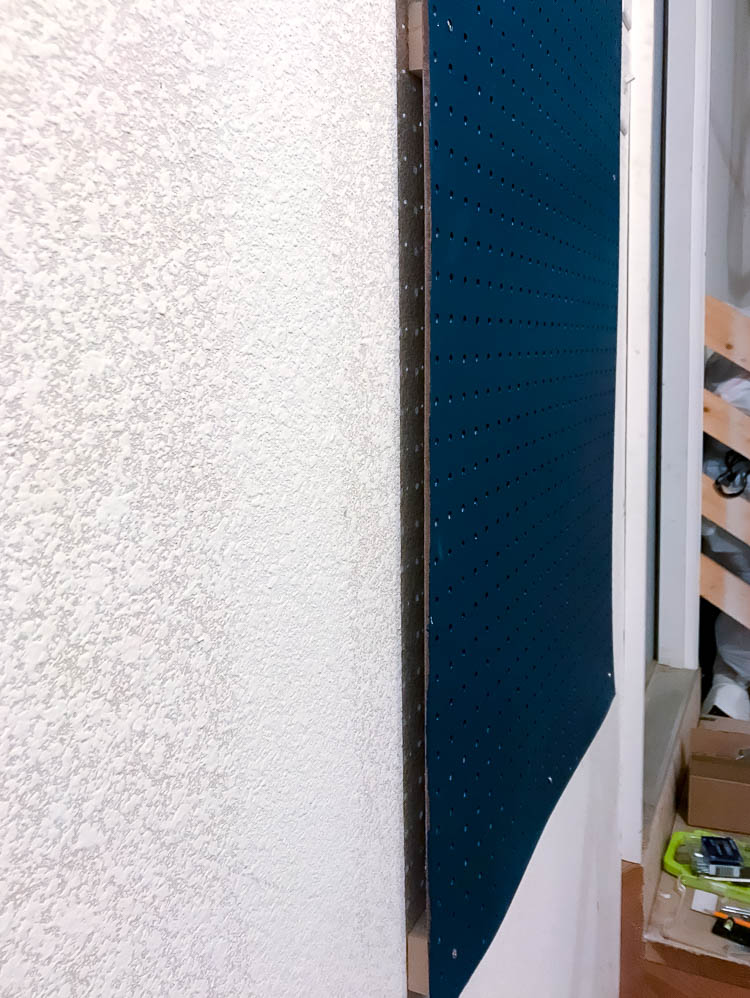 navy-pegboard-mounted-on-garage-wall