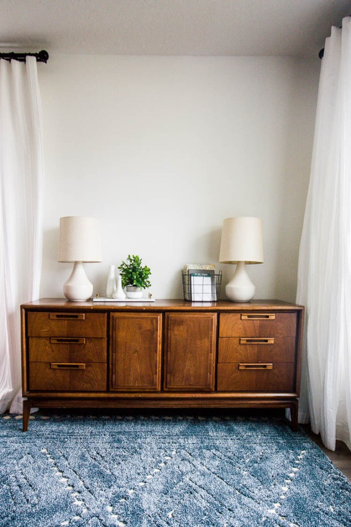 navy-area-rug-in-living-room-with-credenza