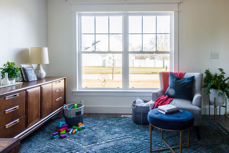 white-front-room-with-diy-window-trim-and-blue-rug