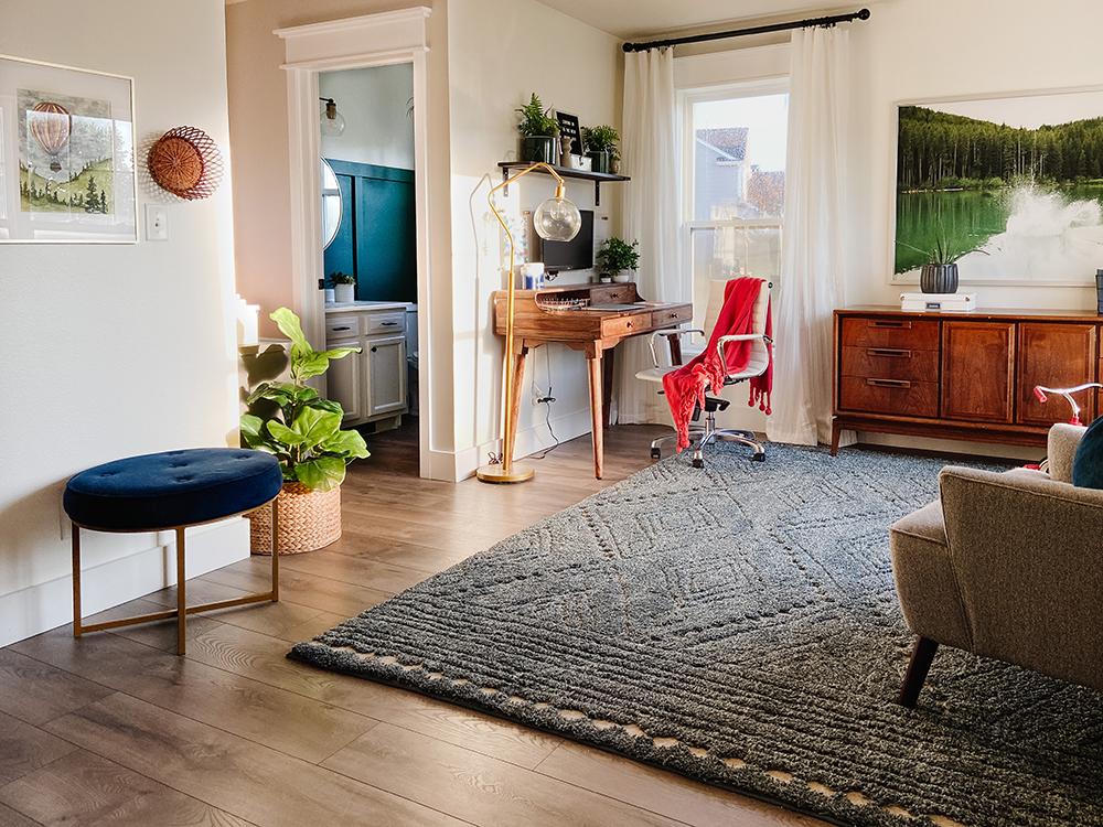 modern front room with desk in corner