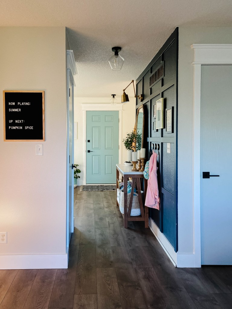entryway with modern decor, letterboard, and blue front door
