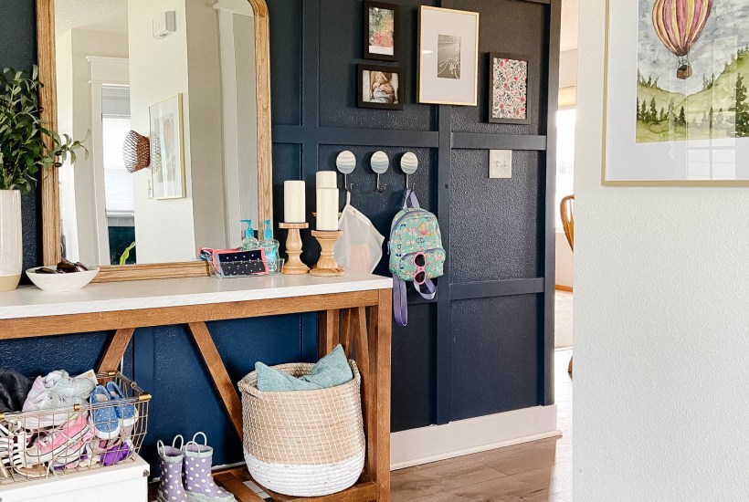 entryway with face masks on table