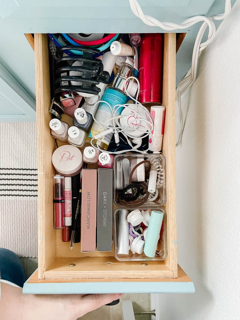 woman's bathroom drawer full of products