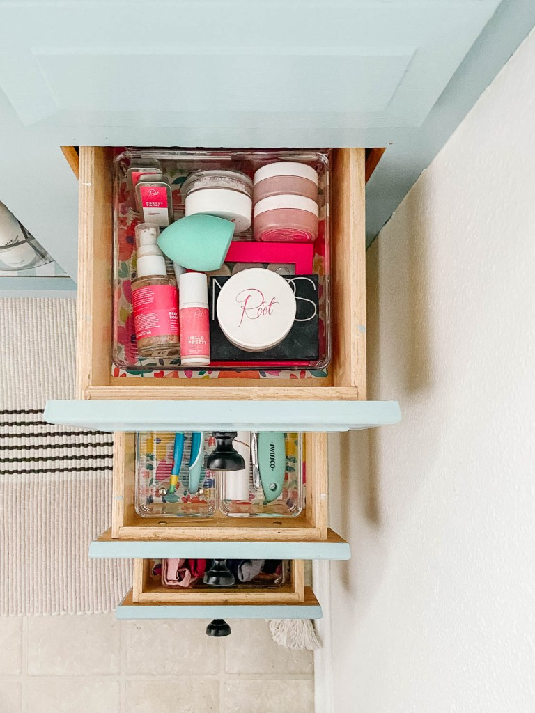 photo showing woman's organized bathroom drawers