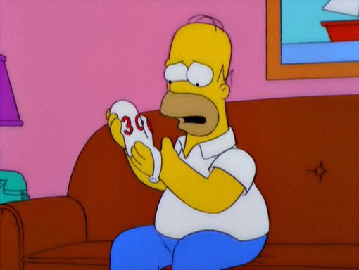 Homer-Holds-the-Deflated-300-Balloon