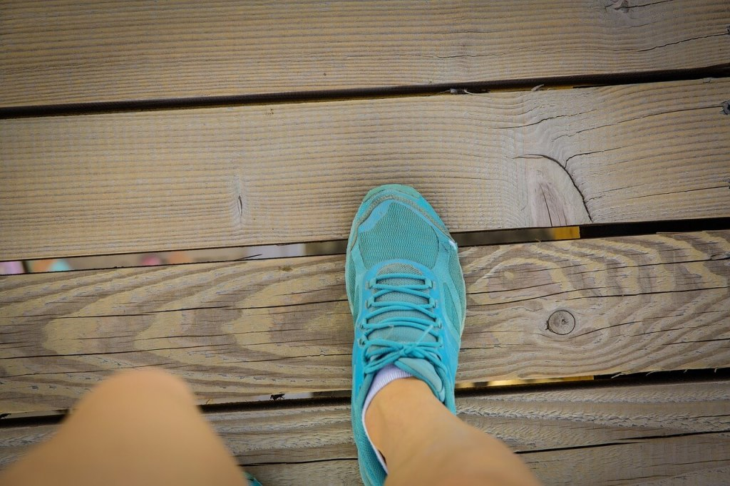blue shoe on foot, in motion