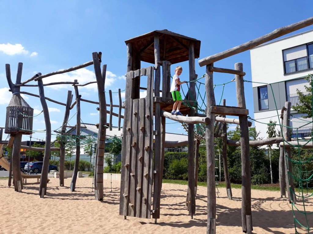 child playing on a playground in Germany