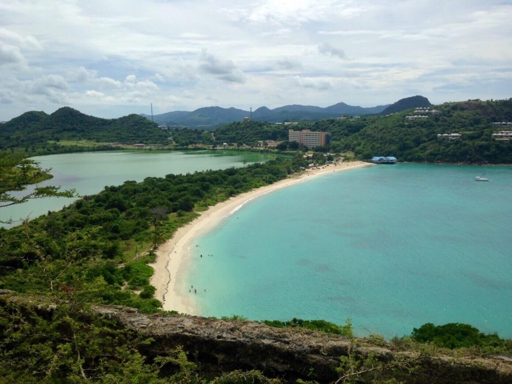turquoise blue waters and resort on Deep Bay, Antigua and Barbuda