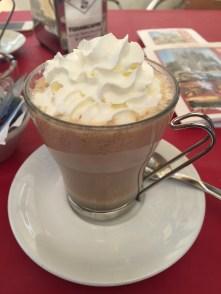 Cappuccino with cream and a frutty sugar