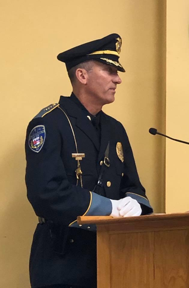 Chief Gilmore makes a speech at the podium after being sworn in.