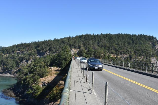 Cars crossing Deception Pass Bridge.