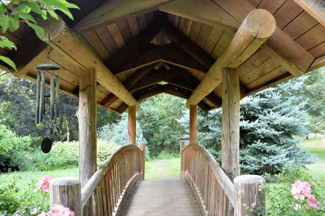 A bridge in the gardens at Village Green Resort.