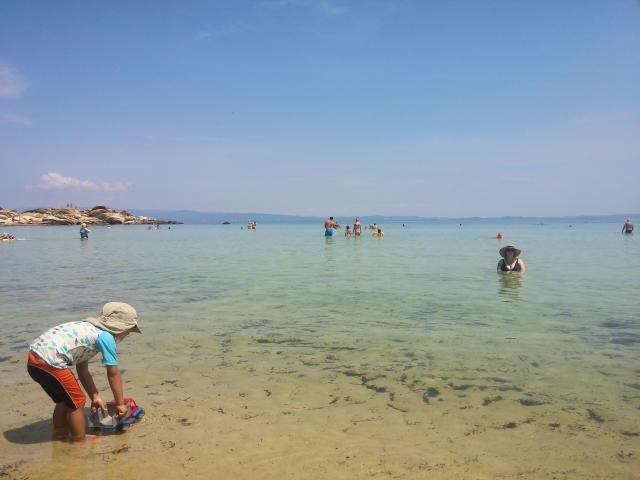 Kids playing at Karidi Beach in Halkidiki Greece.