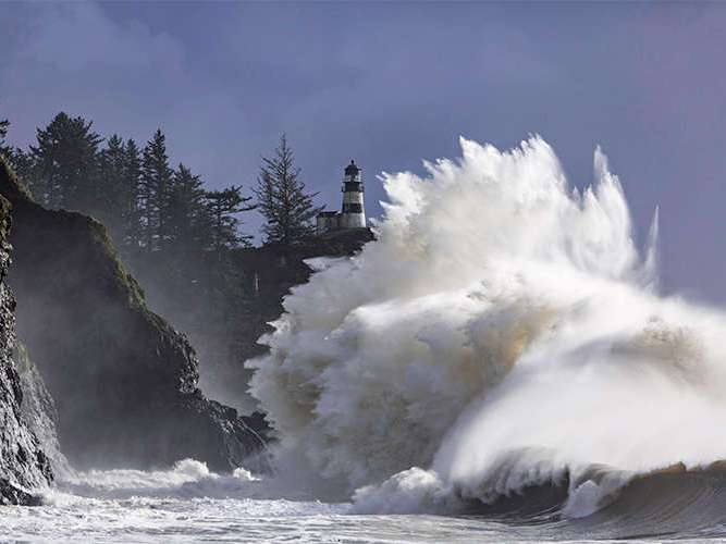 Waves crashing at Cape Disappointment in Long Beach, Washington.