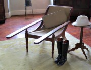 Chair with long arms to easily remove boots. The chair would have been originally on the porch.
