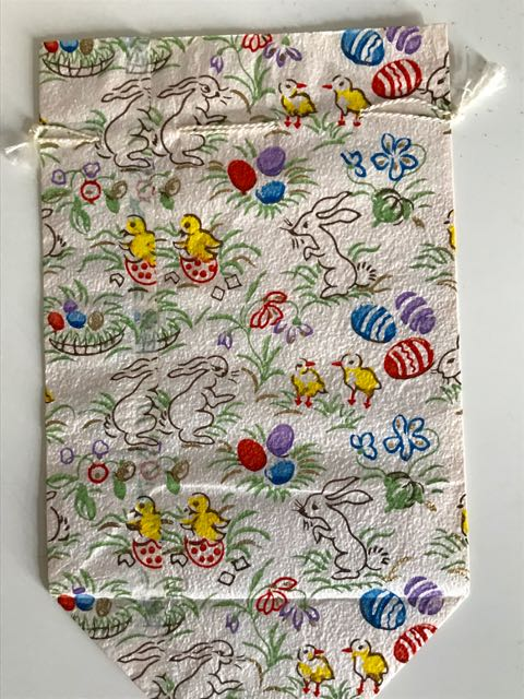 paper bag with printed Easter motifs (chicks, eggs, rabbits)