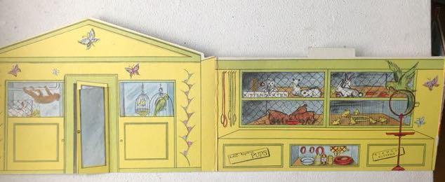 cardboard cut-out illustrated with interior of a Pet Shop (monkey, parrot and rabbits).
