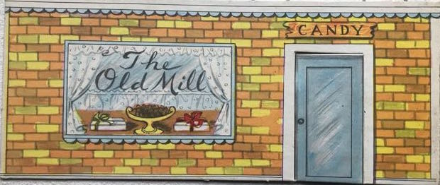 "cardboard cut-out of entrance to fictional café ""the Old Mill"""