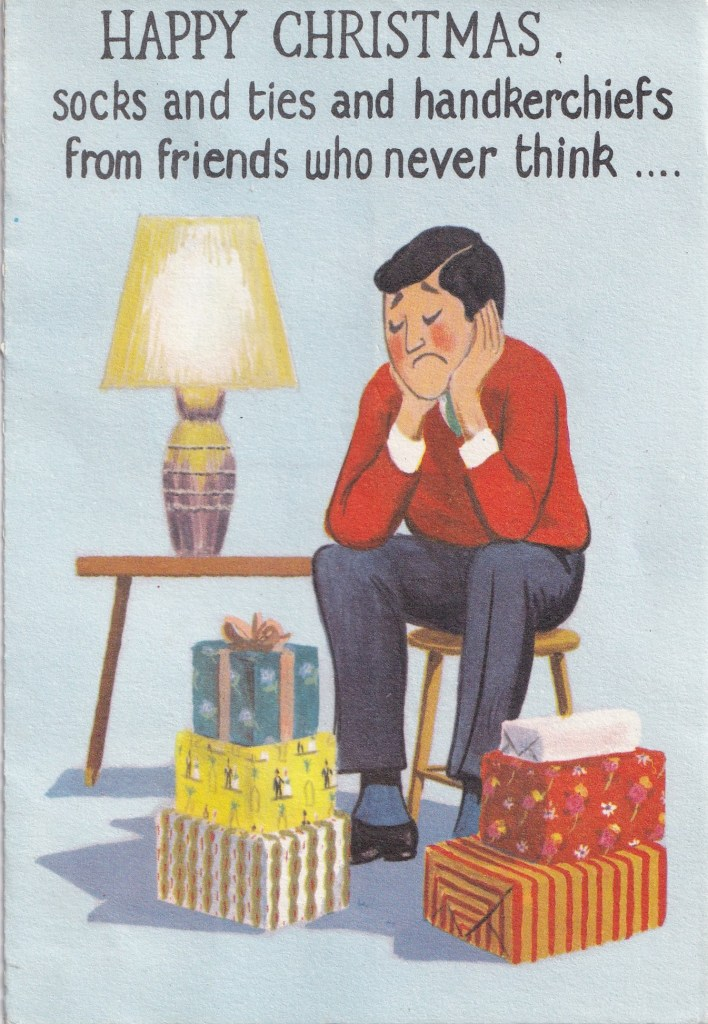 cover of card showing man disappointed at being given socks and ties and handkerchiefs