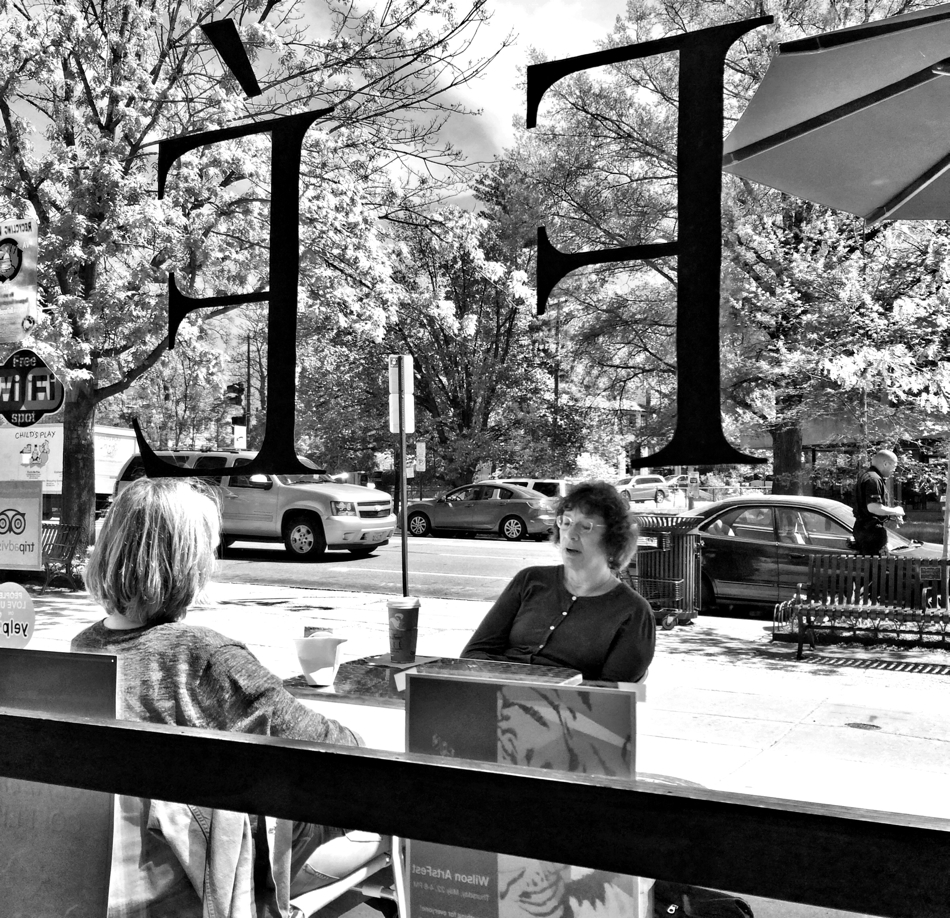 Two woman chatting at the Avalon Theatre Cafe in Chevy Chase, Washington DC
