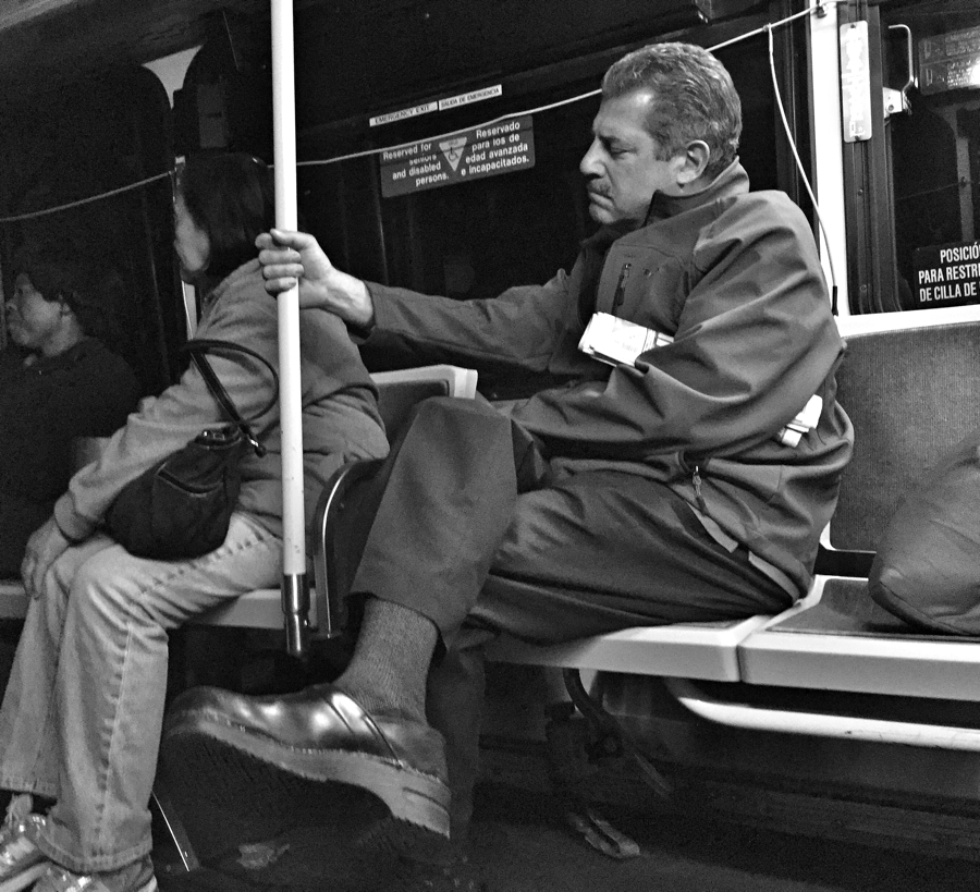 Man lost in thought on the Ride On Bus in Silver Spring, Maryland