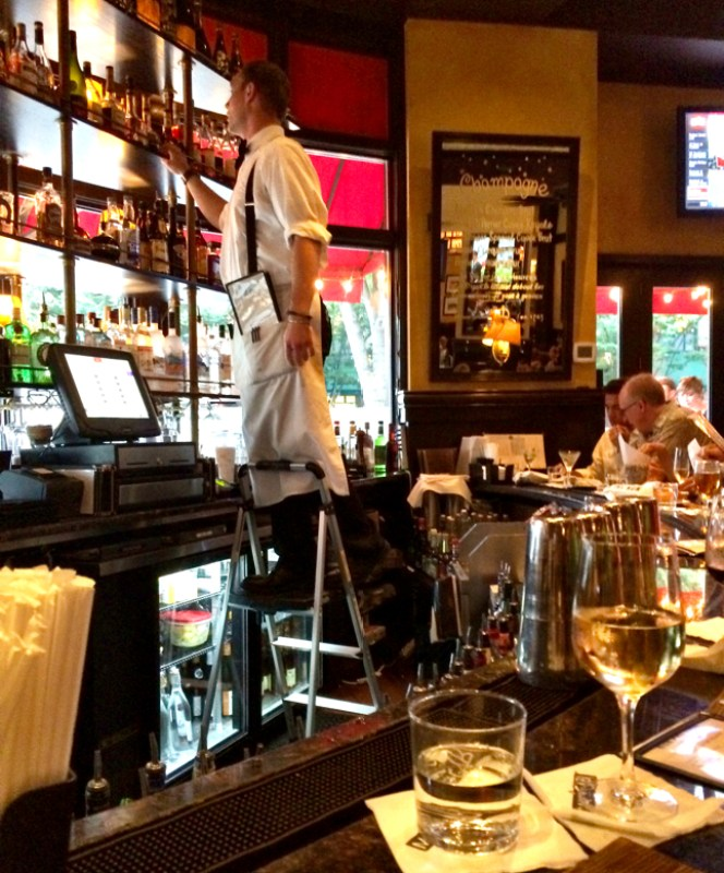 Bartender on a ladder at Mon Ami Gabi in Bethesda, Maryland