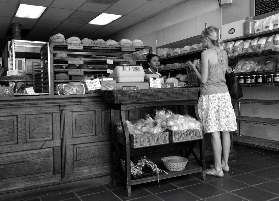 Woman buying bread at Springmill Bakery in Bethesda, Maryland