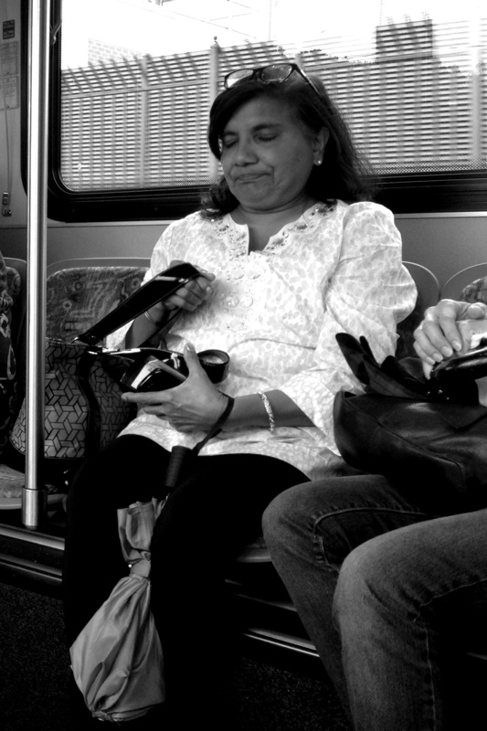 Woman passenger on a bus