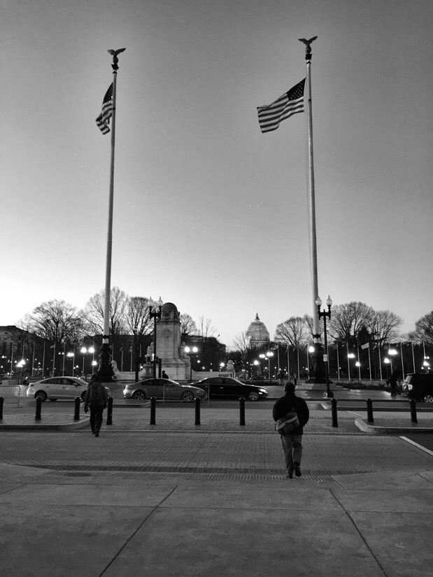 A man walking out of Union Station heading towards the U.S. Capitol Building in Washington DC.
