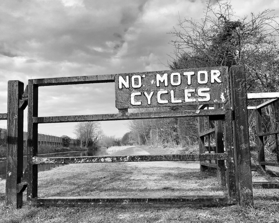 No motor cycles sign on the Leeds Liverpool canal in Bootle, merseyside