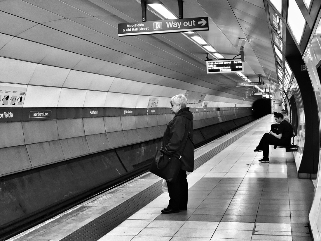 Passengers waiting for their train at Moorfields Station on the Merseyrail system in Liverpool.
