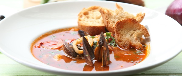 51347639 - fish soup with tomatoes,mussels and baked bread