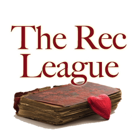 The Rec League - heart shaped chocolate resting on the edge of a very old book