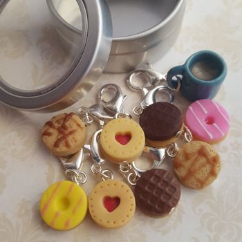 Stitch markers made to look like cookies and a cup of tea