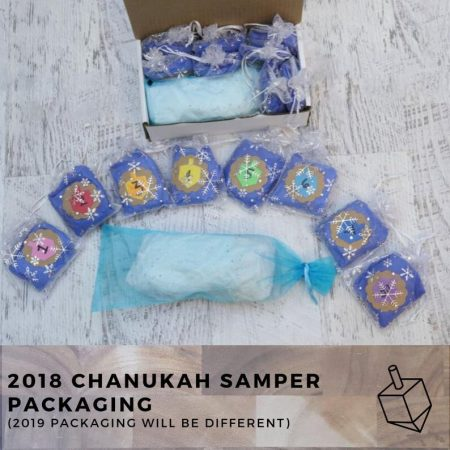 A shot of eight mini skeins packaged for Chanukah