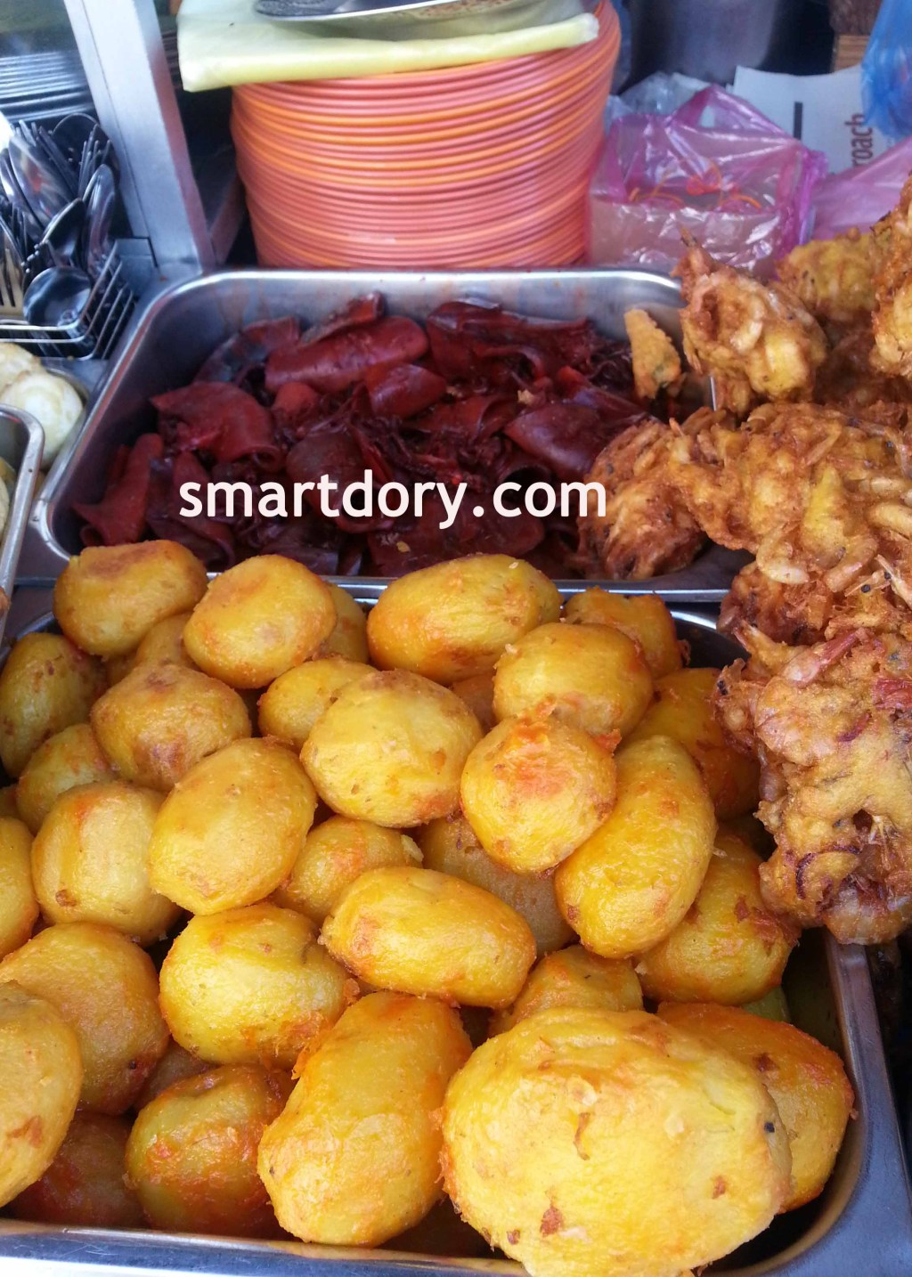 Fried whole potatoes, squid and prawn fritters.