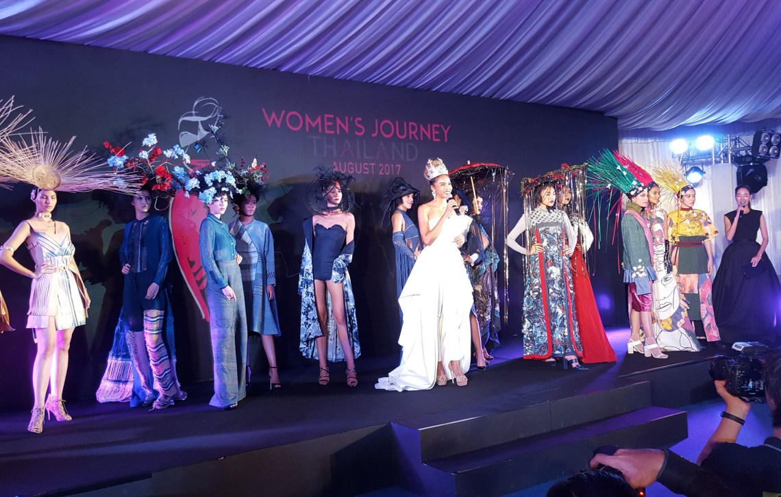 "Photos shows 12 women wearing designer wear on stage with woman in white gown identified as Winner of The FACE Thailand Season 3, Supermodel Natthaya ""Grace"" Boonchompaisarn at the opening ceremony of the Women's Journey Thailand campaign 2017 on 1 August, 2017, at Nai Lert Park Heritage Home in Bangkok."