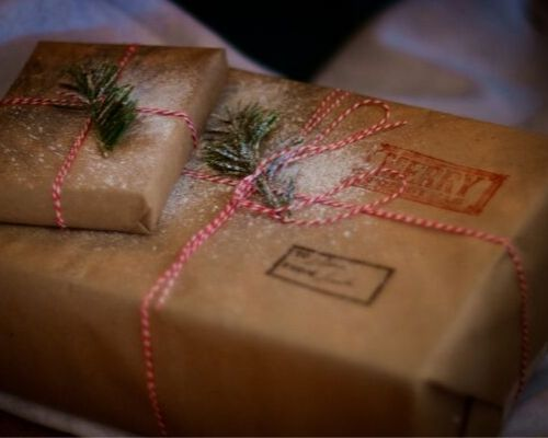inexpensive client gift ideas for small businesses - gift wrapped in a brown envelop