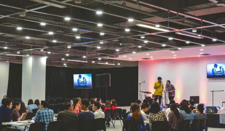 hall full of audience - plan successful year-end business event