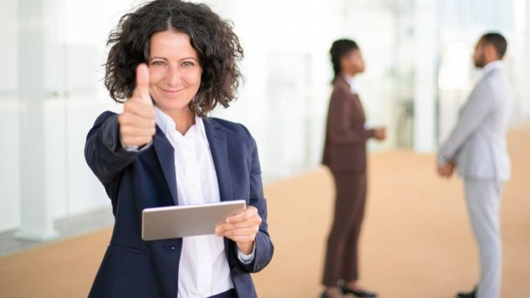 How to get customer testimonial for your business - thumps up - happy business woman