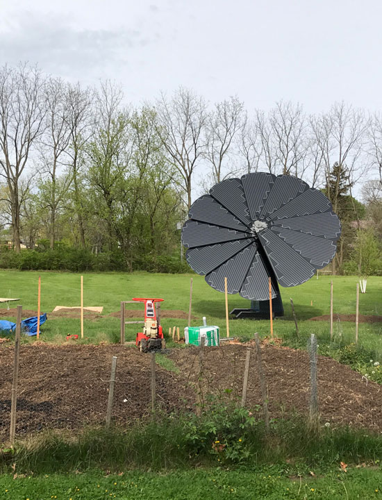 The SmartFlower Solar Panel Overlooks a Small Gardening Patch in the Midwest