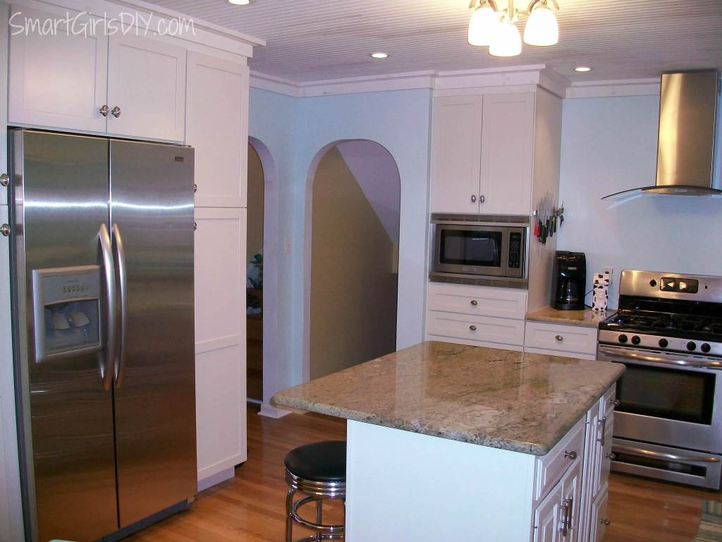 My 1st kKitchen remodel - white cabinets, hardwood floor, stainless steel appliances, island