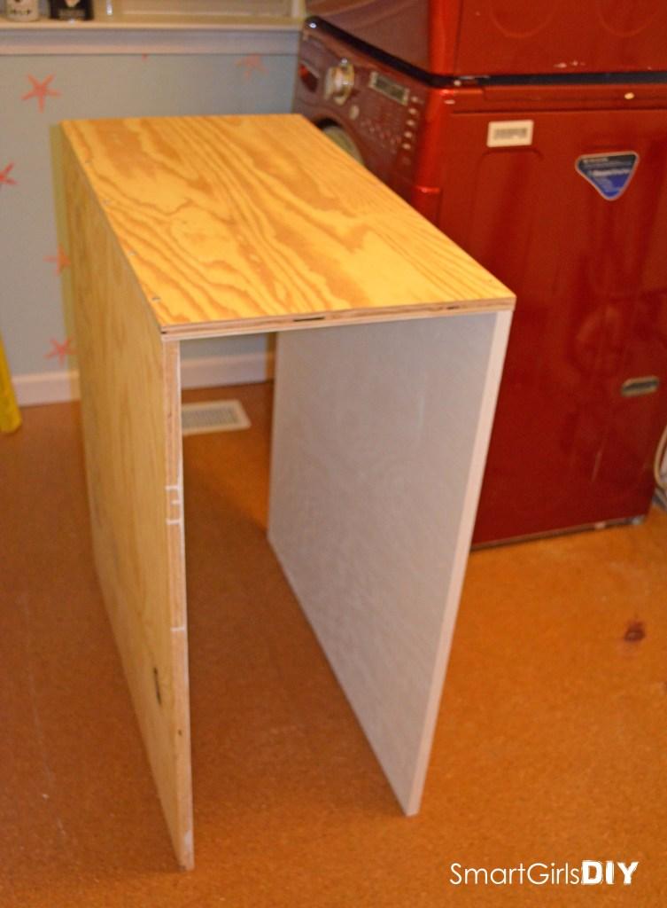 Smart Girls DIY blog - building custom shelf over stacked washer dryer how to
