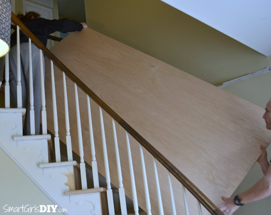 Carrying plywood up stairs for makeover