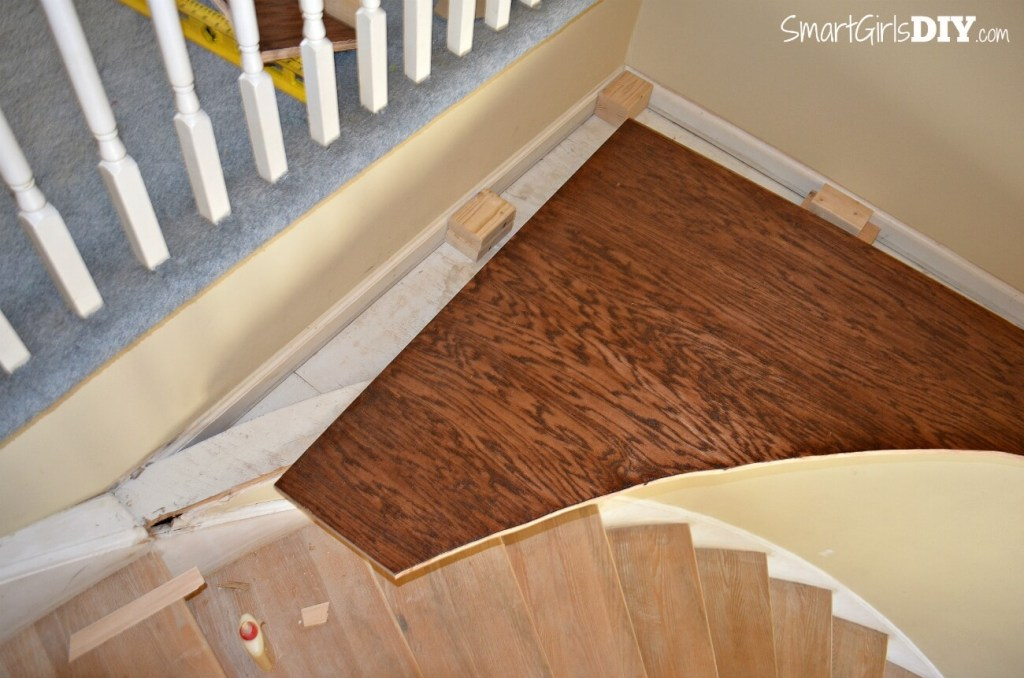 Installing plywood to fix strange platform on circular stairs