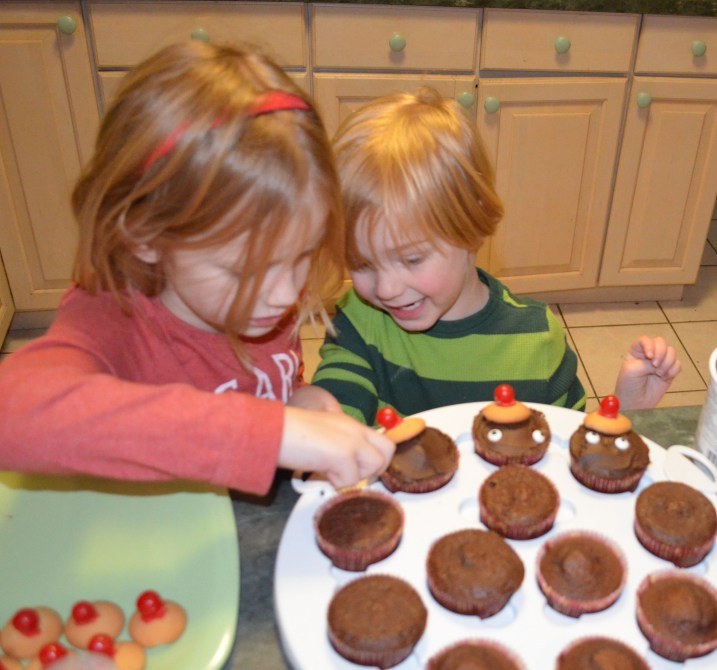 Kiddos working together on Rudolph Cupcakes