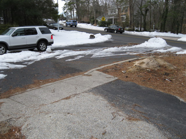 Before - old concrete apron and curb line in the middle of or property